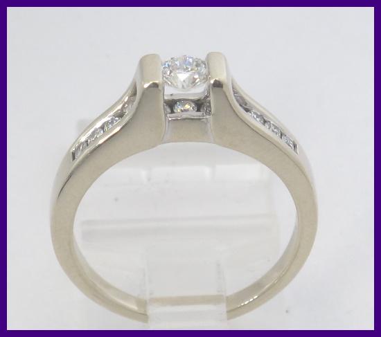 14k white gold floating engagement ring 47ct